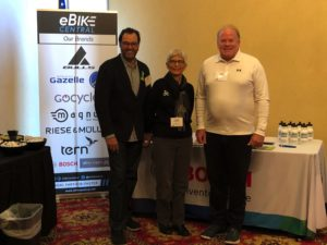 eBike Central at BikeWalk NC Summit in Winston Salem NC. Jore Michel, right with Terry Landsell, Director, and Heidi Perov Perry, Coordinator