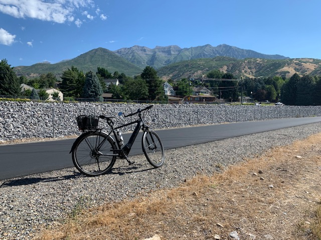 Harry is riding his electric bicycle on the Murdock Provo River Trail in Utah
